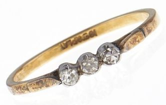 A three stone diamond ring, in gold marked 18ct & PLAT, 2g, size N Light wear