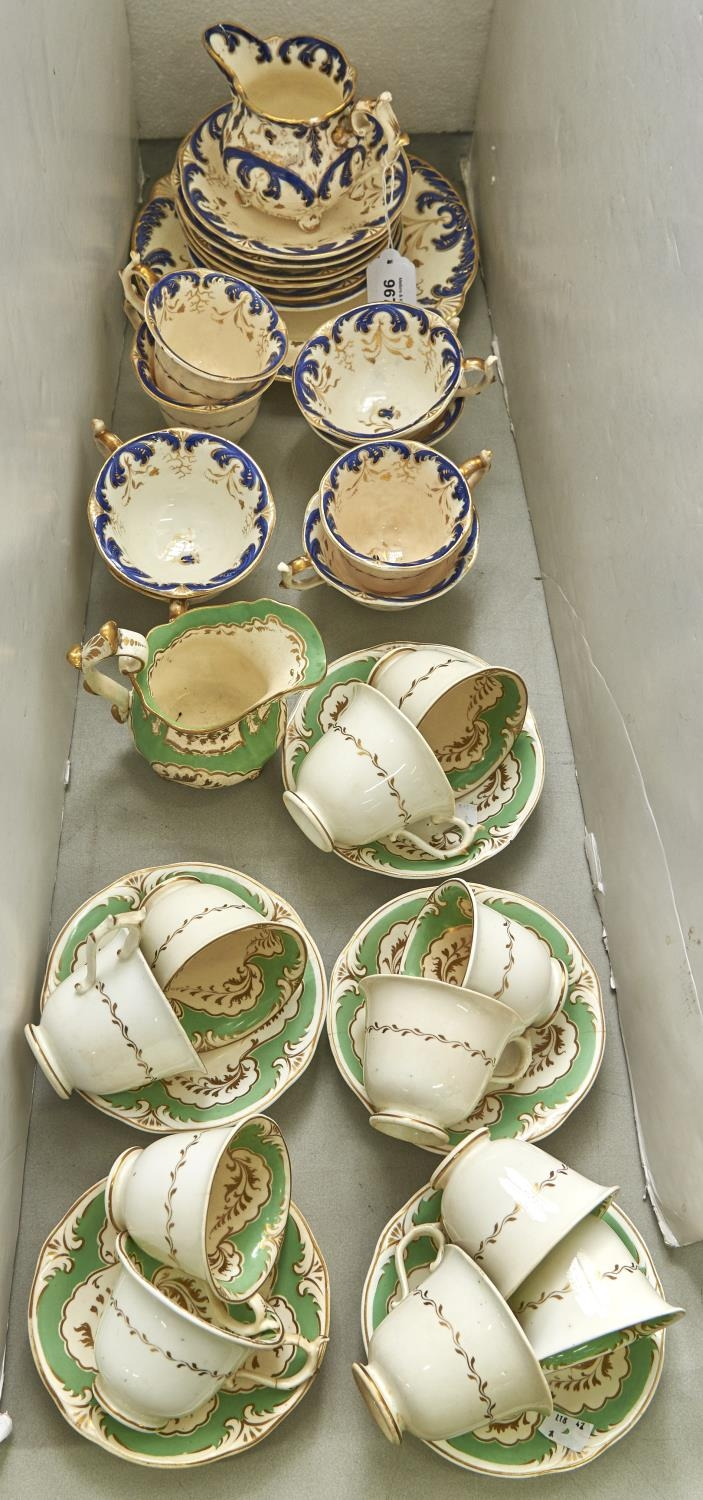 Two Rockingham tea services, c1830-42, of three spur handle shape in green or blue set patterns,