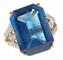 A blue topaz cocktail ring, with diamond shoulders, in gold marked 375, 8.3g, size M Good condition