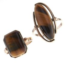 Two tiger's eye rings, in gold marked 9ct, 11.9g, sizes T and Q Good condition