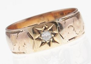 An Edwardian diamond ring, gypsy set, 9ct gold band, Chester 1902, 3.9g, size P Wear consistent with