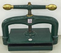 A Victorian brass mounted cast iron book press, base plate 25 x 38cm Re-painted