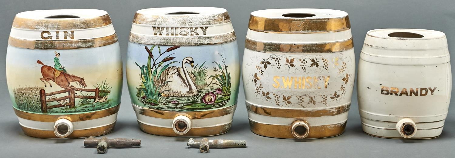Two Victorian gilt earthenware spirit barrels, late 19th c,BRANDY and S WHISKY, 27 and 32.5cm h