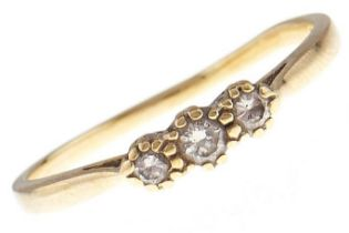 A three stone diamond ring, in 18ct gold, 2.7g, size T Hoop worn and slightly distorted