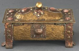 An Arts and Crafts brass and copper casket, early 20th c 15cm l Old solder repair to hinges,