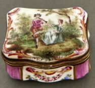 A Continental giltmetal mounted porcelain snuff box, 20th c,of cartouche shape, in 18th c style,
