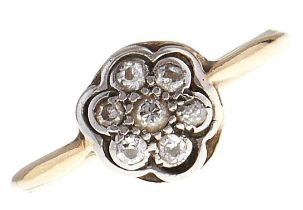 A diamond cluster ring, in gold marked 18ct PLAT, 1.9g, size M Good condition