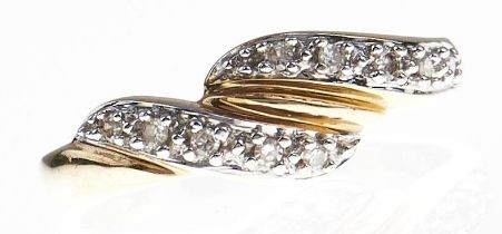 A diamond ring, in two colour gold marked 14k, 2.8g, size N Good condition