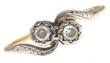 A diamond crossover ring, in gold marked 18ct PLAT, 2g, size O Hoop worn