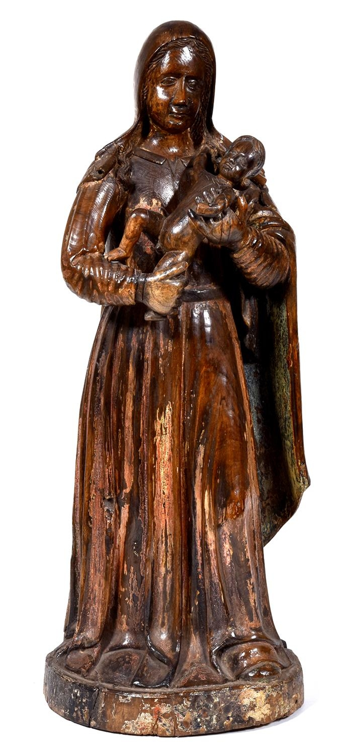 A French polychrome walnut reliquary of the Virgin and Child of so called Monmorillonais Virgins