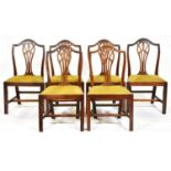 A set of six GeorgeIII mahogany dining chairs, early 19th c, with pierced splat and slip seat, seat