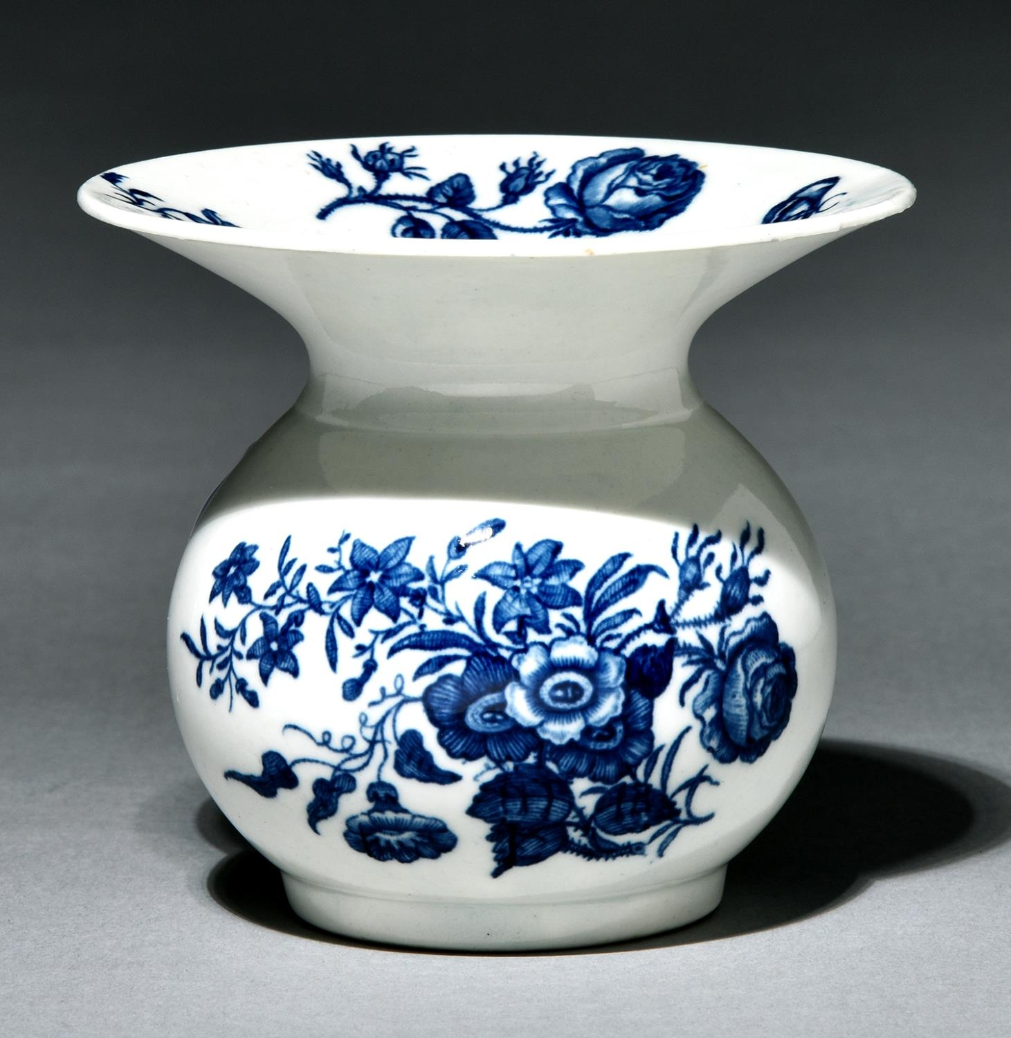 A Worcester spittoon, c1775, transfer printed in underglaze blue with the Three Flowers pattern, 9.
