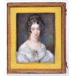 J or T Wheeler (fl. 1817-45) - Portrait miniature of a Lady, her dark hair in ringlets, with gold