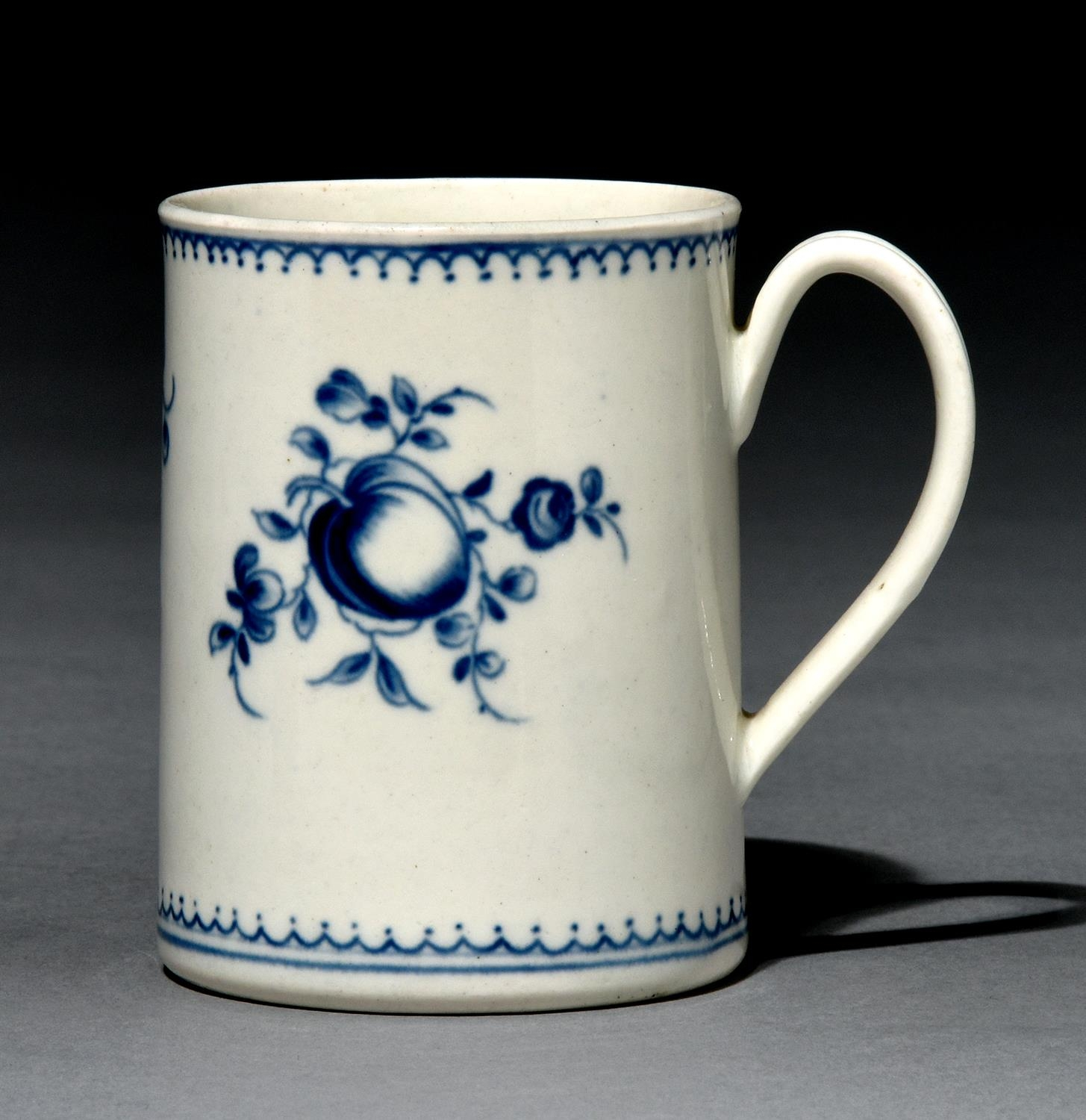 A Worcester mug, c1780, painted in underglaze blue with the Fruit Sprays pattern, 85mm h, crescent