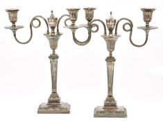 A pair of Old Sheffield plate candelabra, late 18th century, of two lights with looped and reeded