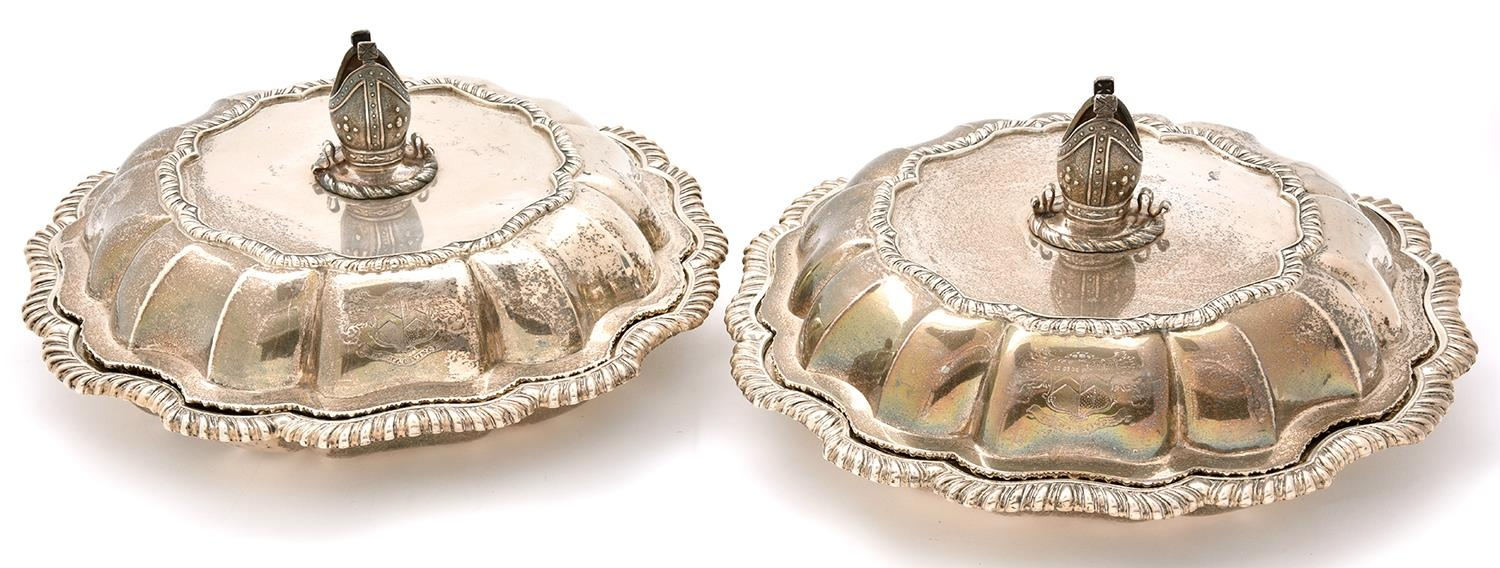 A pair of George IV silver entrée dishes and covers, of lobed and fluted round design with gadrooned