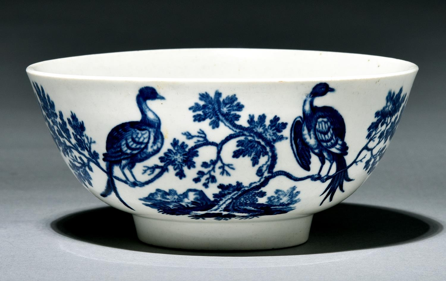 A Worcester bowl, c1780, transfer printed in underglaze blue with the Birds in Branches pattern,