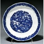 A blue printed pearlware saucer dish, c1790, with a full Nankin type pattern, 18cm diam Good