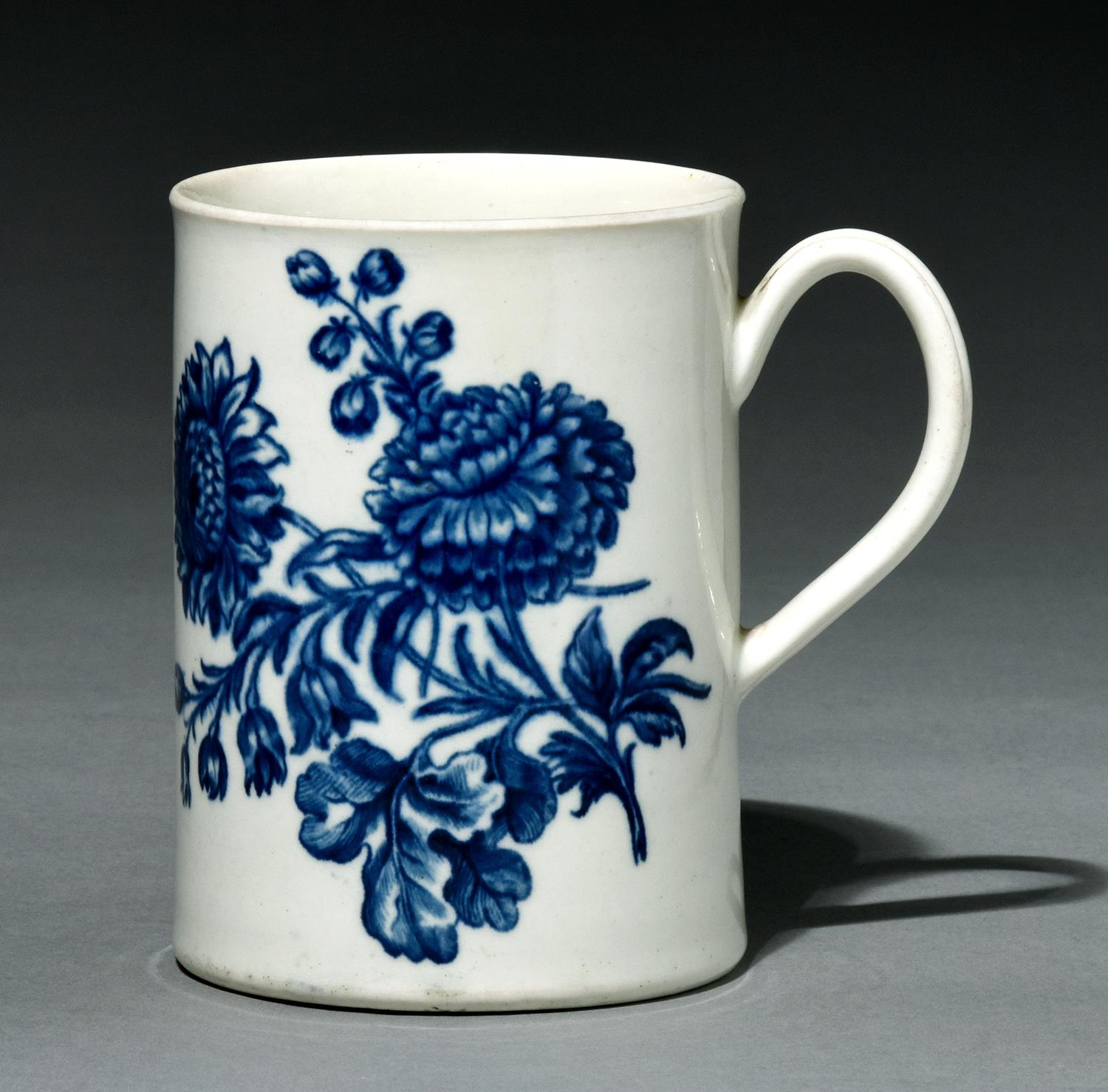 A Worcester mug, c1760-70, transfer printed in underglaze blue with the Natural Sprays Group