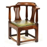 A George III fruitwood corner armchair, late 18th c, with padded leather seat, seat height 39cm