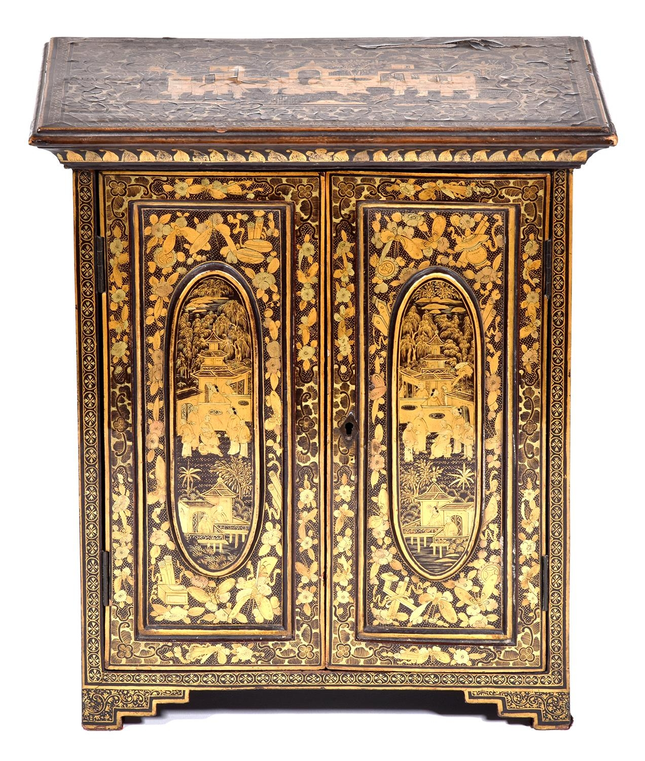 A Chinese black and gold export lacquer table cabinet, early 19th c, the panelled doors enclosing