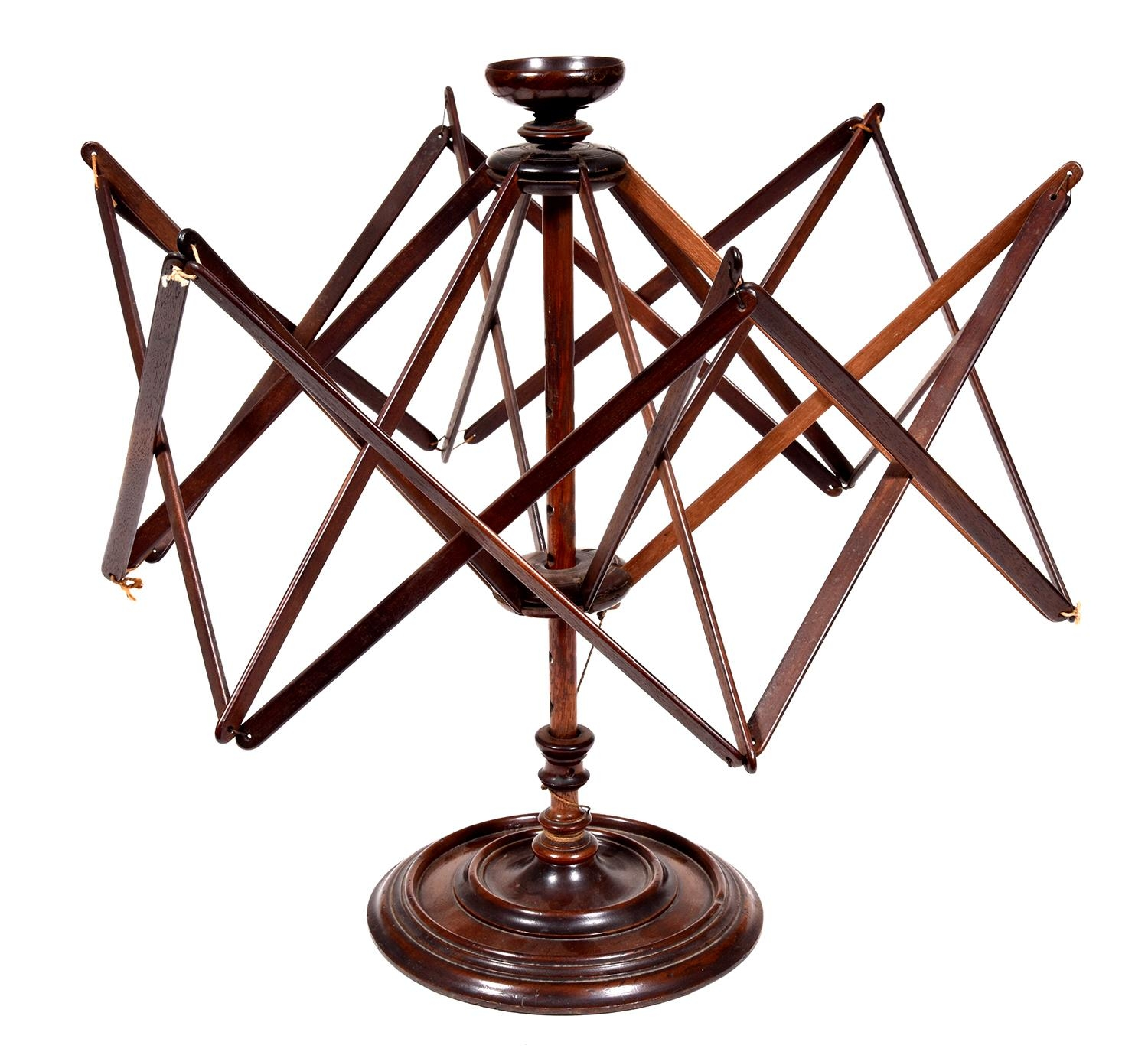 A George III mahogany swift, c1800,weighted with lead annulus, 47cm high Provenance: Heathcote Ball