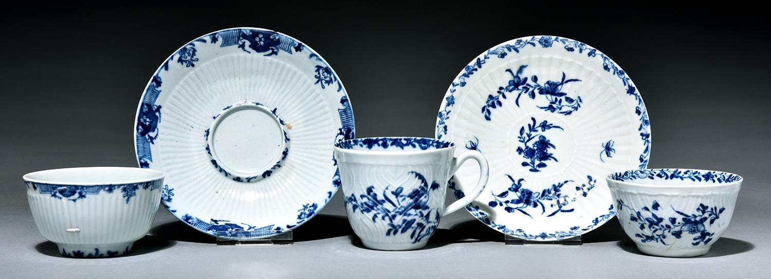 A Worcester feather moulded trio and reeded tea bowl and socketed saucer, c1760, painted in