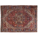 An antique Heriz carpet, early 20th c, 272 x 373cm Localised wear and soiling