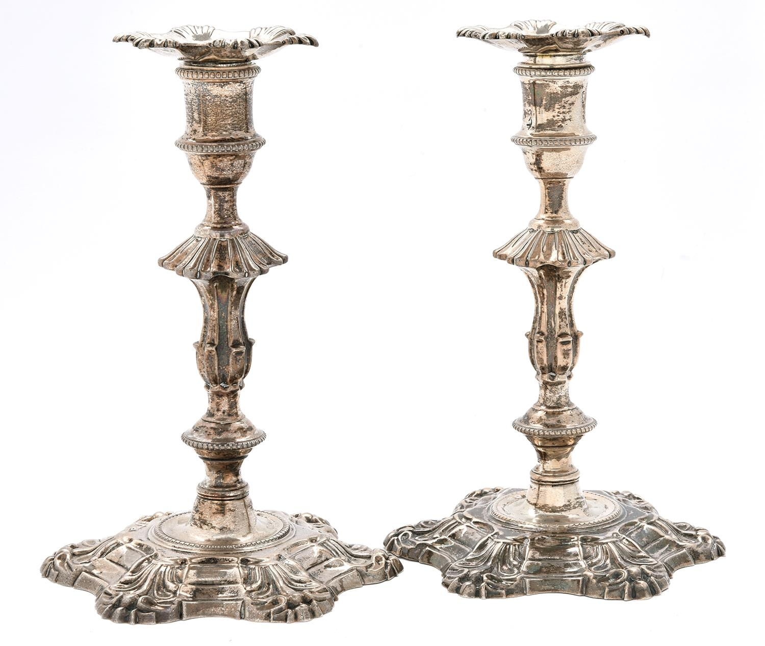 A pair of George III cast silver candlesticks, with shells, knopped stem and beaded rims, 19cm h,