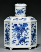 An hexagonal Chinese blue and white tea caddy and cover,painted with dogs of Fo and flowers, 19cm