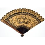 A Chineseblack and gold export lacquer fan, early 19th c,decorated to either side with a