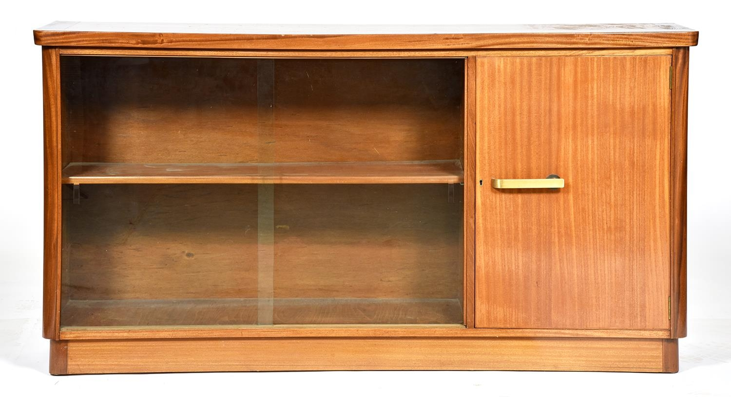 A mid century light wood bookcase, c1960,of solid and laminate construction, adjustable shelves,