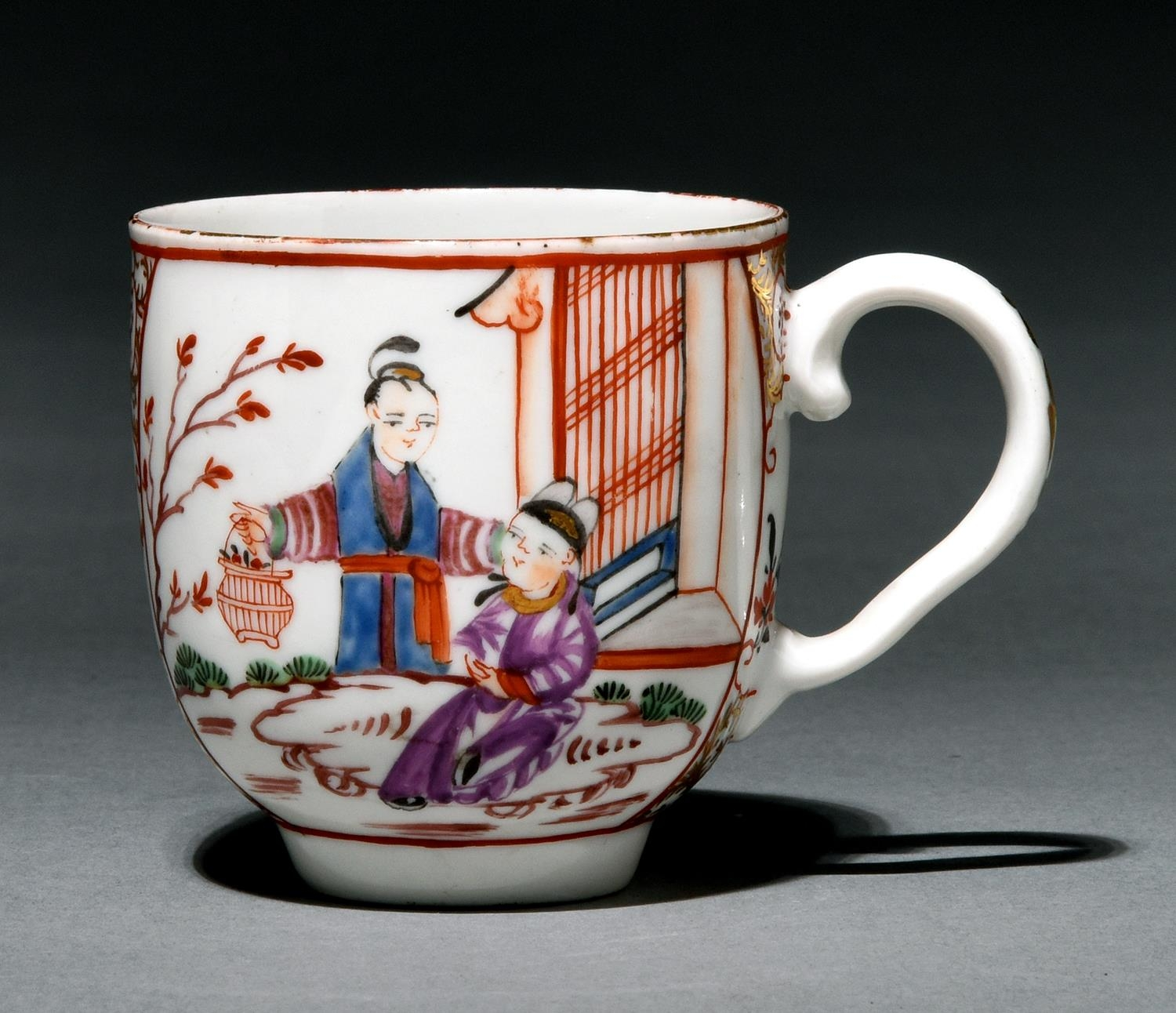 A Bristol polychrome coffee cup, c1775, painted in famille rose style with two reserves of Chinese