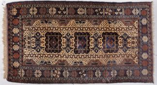 A Persian style blue ground rug, 110 x 200cm Good condition