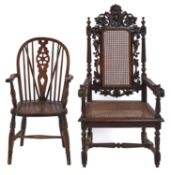 A Victorian carved oak armchair, with caned back and seat, seat height 42cm and an ash wheelback