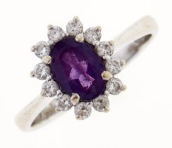 An amethyst and white stone cluster ring, in white gold, marked 14K, 3.1g, size K Good condition