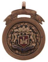 A 9ct gold and enamel watch fob shield, Birmingham 1925, 5.8g Worn