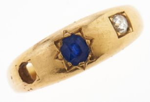 A sapphire and diamond ring, c1900, gipsy set, in gold, marked 18ct, 6.1g, size S One stone