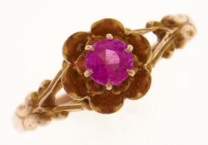 A synthetic ruby ring, in gold, marked 10K, 1.6g, size O Good condition