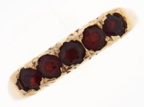 A garnet ring, in gold, marked K18, 2.1g, size O Good condition