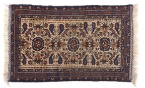 A Persian style blue bordered rug with fawn field, 84 x 143cm Good condition
