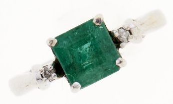 An emerald and diamond ring, with larger central step cut emerald, in 9ct white gold, 2.2g, size G
