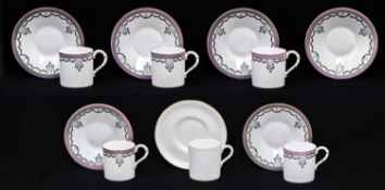 A set of five Royal Worcester coffee cups and saucers, 1914, with green and blue swags and lilac