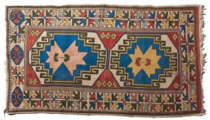 A rug - 135 x 232cm and a smaller light blue ground medallion rug (2) Light wear and slight fading