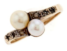 A pearl and white stone crossover ring, in gold, unmarked, 2.5g, size L Light wear scratches