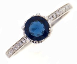 A sapphire and diamond ring, in white gold, marked K18, 1.9g, size N Good condition