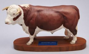 A Beswick model of a Hereford Bull, 1976-1989, wood base, 18.5cm h Good condition