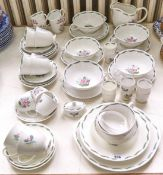 A Wedgwood bone china part dinner service, designed by Susie Cooper, mid 20th c, printed mark Good