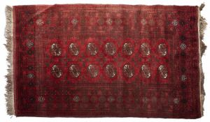 A red ground Bokhara rug - 120 x 196cm Light wear and localised soiling