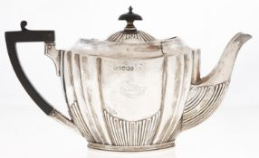 A Victorian silver teapot, of fluted oval shape, crested, 13.5cm h, by Lee & Wigfull, Sheffield